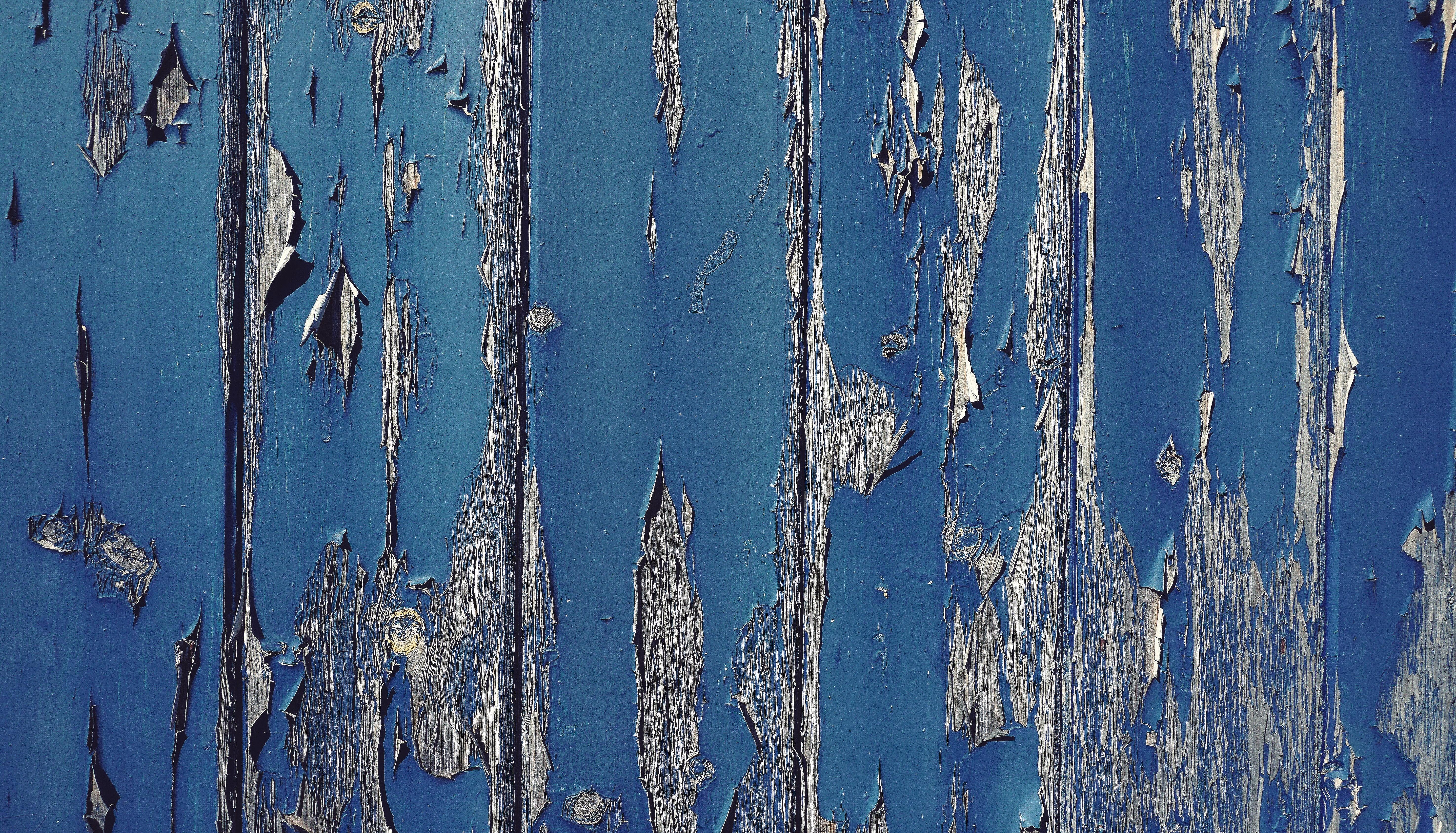 Gray wood with cracked blue paint