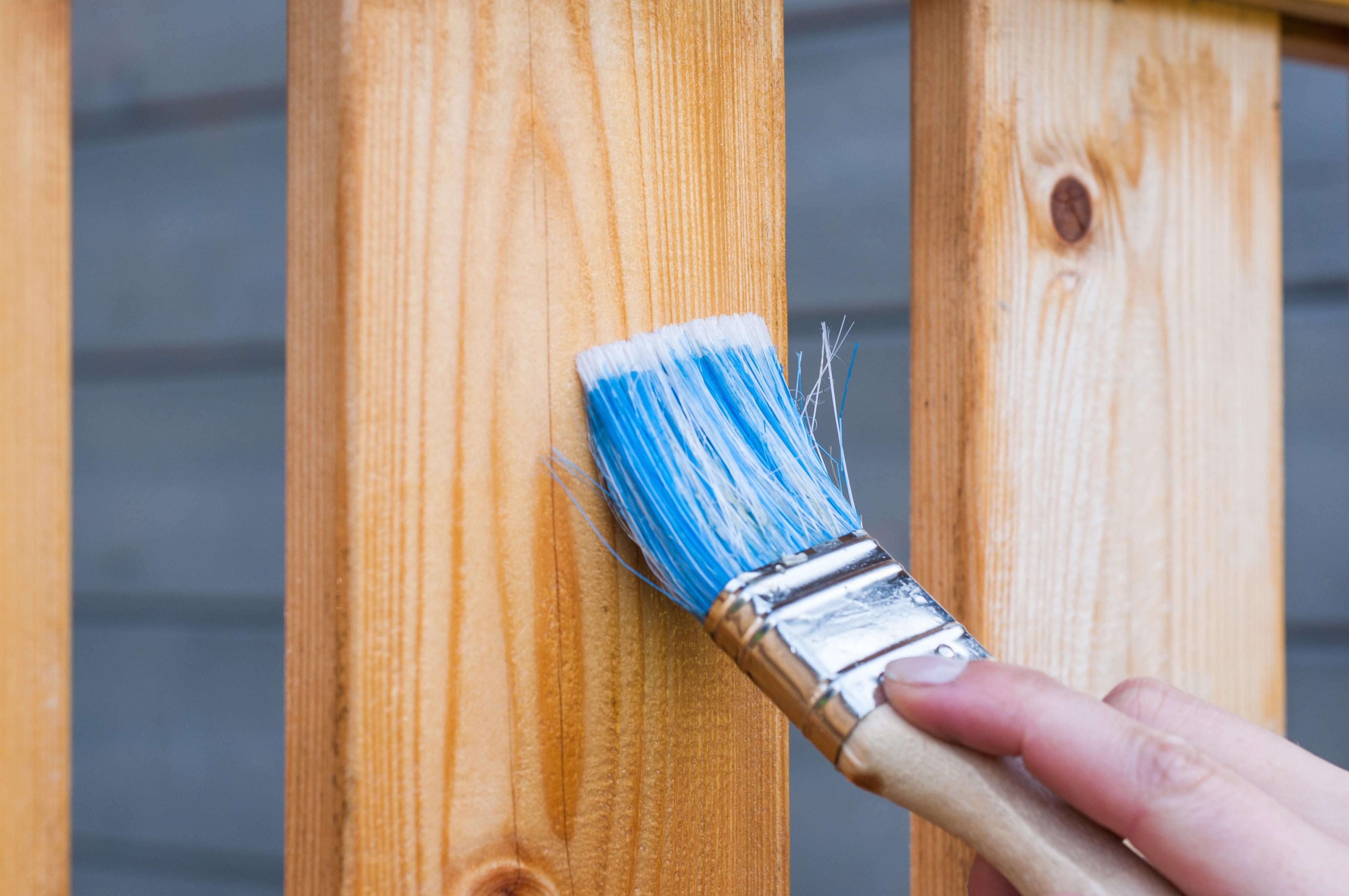 Blue Paint Brush on Wood